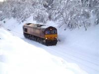 <I>Here comes the cavalry... </I> EWS 66112 makes its way through the snow en route to the Carrbridge crash site on the morning of 11 January 2010 to provide assistance with the ongoing container recovery operation.<br><br>[Gus Carnegie 11/01/2010]