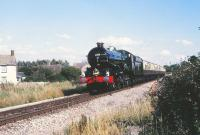 6000 <I>King George V</I>, northbound at Purton station on the Swindon - Gloucester line on 21 August 1985. Star of the GWR 150 celebrations. (The 175 'do' is now rapidly approaching.)<br> <br><br>[Peter Todd&nbsp;21/08/1985]