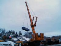 Under fading light at Carrbridge on 11 January the Ainscough crane (the 5th crane to be used) works flat out lifting the containers. [See addendum to today's Railscot News Item.]<br><br>[Gus Carnegie 11/01/2010]