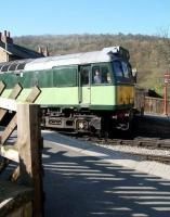 First train of the day from Pickering, hauled by D7628, waits at the level crossing at Levisham on a fine spring morning in April 2009, before continuing its journey north with a service for Grosmont.<br><br>[John Furnevel&nbsp;20/04/2009]
