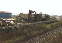 Loading in progress at the <I>European Metal Recycling</I> depot at Laisterdyke, Bradford, on 1 April 1998. EWS 37716 can be seen on the far right at the head of the train currently being loaded, which will eventually be heading for Liverpool's Alexandra Dock following a reversal at Bradford Interchange [see image 26953].<br><br>[David Pesterfield&nbsp;01/04/1998]
