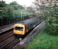 Experimental-liveried 101 692 pulls out of Cumbernauld with a Motherwell service (its usual diagram) in September 1997.<br><br>[David Panton&nbsp;/09/1997]