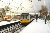 A service heading to Hazel Grove from Preston in the hands of 142046 calls at a snowy Leyland on 23 December 2009.<br><br>[John McIntyre&nbsp;23/12/2009]