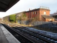 The old Great Western Railway Goods Shed (and later extension) still stands on the east side of line by Wrexham General Station. The former railway goods depot is now a builders merchants yard.<br><br>[David Pesterfield&nbsp;22/12/2009]