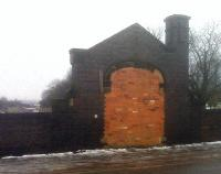 A bricked up entrance, a chimney and a storage space within the bridge pier are all that remains at this former suburban station on the North side of Leicester; although one track has been relaid. The awning of the more recent Leicester North station can just be seen over the parapet to the left of the entrance.<br><br>[Ken Strachan&nbsp;15/01/2010]