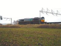 DRS 66419 waits at signals near Winsford on 24 November 2009 with a John G Russell return working to Scotland from Daventry International Rail Freight Terminal. <br><br>[David Pesterfield&nbsp;24/11/2009]