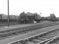 Black 5 no 44719 with assorted accompaniment at the west end of Corkerhill shed yard in July 1962.<br> <br><br>[Colin Miller&nbsp;/07/1962]