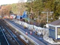 Scene at Carrbridge on 18 January with recovery work continuing. 66048 is covered by the green tarpaulin in the centre of the picture. There may be some second thoughts about how best to remove the locomotive, with Carillion having stopped work on the temporary road from the A9 to the trackside.<br><br>[Gus Carnegie 18/01/2010]