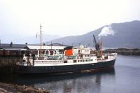 Plenty of goods vans and an operational steam crane in evidence at Kyle of Lochalsh in the summer of 1966 as <I>Loch Seaforth</I> calls en route from Mallaig to Stornoway.<br><br>[Frank Spaven Collection (Courtesy David Spaven)&nbsp;//1966]