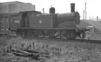 McIntosh 2P 0-4-4T no 55222 stored alongside Stirling South shed in the late 1950s. Official withdrawal by BR came in 1961 with disposal through Inverurie works the following year.<br><br>[K A Gray&nbsp;//]