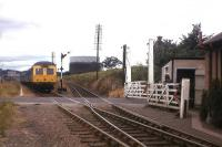 An Aberdeen-bound DMU approaches Millburn Junction level crossing in Inverness in 1976. The route leading up to the Highland Main Line on the right was known as the 'Burma Road' due to its wartime military use, and enabled freights from the Aberdeen direction to run directly into Millburn Yard - a move no longer possible.<br><br>[Frank Spaven Collection (Courtesy David Spaven)&nbsp;//1976]