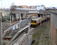 In this view from the east, Exhibition Centre station presents a <br> deceptively junction-like appearance. In fact the track on the far left is a siding, and platforms 2 and 1 serve the Argyle Line westbound and eastbound respectively. The westbound track remains in the open and joins the North Clyde Line at Finnieston East Junction, while the track from Finnieston West has had to burrow under the North Clyde Line (among other things) in the 950yd Kelvinhaugh Tunnel which opens straight onto Platform 1. From there 318261 departs for Larkhall on 20 January. <br> <br><br>[David Panton&nbsp;20/01/2010]