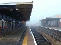 Although Barrow is a comparitively modern station, it was eerily quiet between trains on this cold January day when the fog never lifted. Three platforms remain in use, including the two through roads shown and a bay for northbound trains only behind the buildings on the right. <br><br>[Mark Bartlett&nbsp;23/01/2010]