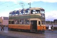 A Glasgow tram at the Auchenshuggle terminus on 4th August 1962, exactly one month before the last trams ran on this last city tramway in Great Britain (prior to the construction of new systems in the 1990s). The tram is Mark 1 Coronation 1148, one of the original batch from December 1937, withdrawn on 1 September 1962. (It had to be rebodied in May 1951 after the fire at Newlands Depot.)<br><br>[Frank Spaven Collection (Courtesy David Spaven)&nbsp;04/08/1962]