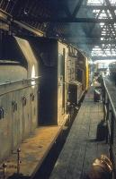 Following its relatively short stint as a passenger terminus (1903 - 1952), Leith Central was subsequently adapted for use as a diesel depot and given the shed code 64H. Part of the converted depot is shown here in 1971 looking out from the former station concourse, with Barclay 0-4-0DM D2435 nearest the camera. Leith Central diesel depot was officially closed in 1972, following which the old building lay derelict for many years. During that period it became something of a haven for drug addicts (and the inspiration for the Irvine Welsh novel <I>Trainspotting</I>). Final demolition and clearance took place in 1989 and the site is now occupied by a supermarket, a swimming pool and associated car parking, although the old station frontage is still a notable landmark at <I>the Foot of the Walk</I> [see image 11184].  <br><br>[Bill Roberton&nbsp;//1971]
