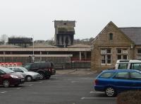 Coaling towers were once a distinctive skyline feature in many places but are very rare now. The tower at Carnforth is a concrete post-war structure and survives in the West Coast Railway depot although it is no longer operational. It is seen here from Carnforth station car park with the depot water tower alongside. The old main line platforms and the subway entrance can be seen to the left of the station building, which now houses a travel centre booking office and small businesses.<br><br>[Mark Bartlett&nbsp;26/01/2010]