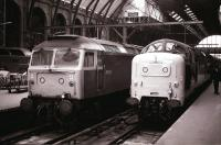 Deltic 55013 <I>The Black Watch</I> stands at Kings Cross alongside 47528 in June 1978.<br><br>[Peter Todd&nbsp;27/06/1978]