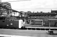 Scene at Kings Cross on 27 June 1978 with Deltic 55013 <I>The Black Watch</I> leaving the platforms and a pair of 31s acting as station pilots. <br><br>[Peter Todd&nbsp;27/06/1978]