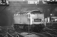 The driver of 47547 looks back from the cab window as he slowly reverses onto his train at Kings Cross on 20 March 1976.<br><br>[John McIntyre&nbsp;20/03/1976]
