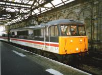 86 244 <I>The Royal British Legion</I> in BR <I>InterCity</I> livery awaits its departure time at the old Waverley Platform 10 in December 1994 with a train for Birmingham New Street.<br><br>[David Panton&nbsp;/12/1994]