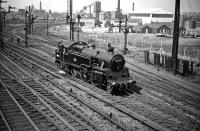 Standard class 4 2-6-4T no 80129 has just moved off Polmadie shed on its way to Glasgow Central to pick up empty stock in May 1959. The locomotive is about to pass 'Dixon's Blazes', site of the last operational blast furnace within the City of Glasgow, closed down the previous year. <br><br>[A Snapper (Courtesy Bruce McCartney)&nbsp;16/05/1959]