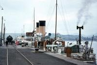 The <I>Duchess of Montrose</I> at the Gourock Pier fuelling berth in 1964 with an oil tank stabled in the siding on the quayside. Note members of the public happily wandering amongst the clutter.<br><br>[Colin Miller&nbsp;//1964]