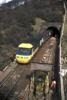 A southbound HST creeps out of Penmanshiel Tunnel on 15 March 1979, two days before the tragic tunnel collapse in which two men died. (The tunnel works were being undertaken to increase the line's loading gauge to accommodate the new generation of containers.)  As the tunnel was in such a dangerous condition following the collapse, the line was subsequently rerouted and the tunnel sealed, with the men's bodies left entombed. A memorial now stands on the hillside above the tunnel. [See image 28041]<br> <br><br>[Frank Spaven Collection (Courtesy David Spaven)&nbsp;15/03/1979]