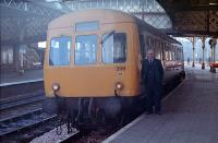 Driver Ronnie Guthrie poses next to a Perth - Dundee service DMU which is about to set off on 25 January 1989.<br><br>[Ewan Crawford&nbsp;25/01/1989]