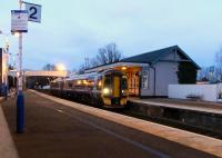 Dusk at Inverkeithing station on 30 January as 158 726 calls on a returning Fife local.� Hard behind the platform the deep Keithing Burn slips by so quietly that, even in the silence following a departed train, you wouldn't know it was there. <br> <br><br>[David Panton&nbsp;30/01/2010]