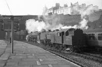 Scene at Birkenhead Woodside station with Fairburn 2-6-4T no 42086 standing in the foreground as a Black 5 takes a train out of the terminus towards Woodside Tunnel. The photograph is thought to have been taken on 3 March 1967.<br> <br><br>[Robin Barbour Collection (Courtesy Bruce McCartney)&nbsp;03/03/1967]