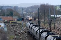 I can just imagine the driver of the Freightliner pulling out his newspaper and perhaps reaching for a Thermos. The southbound loaded coal train was paused here while a number of Voyagers and Pendolinos sped past.<br><br>[Ewan Crawford&nbsp;28/01/2010]