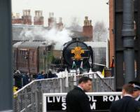 A1 no 60163 'Tornado' at the head of the Royal Train having recently arrived from Preston at Manchester Liverpool Road station, now part of the Museum of Science and Industry. The photo is taken from Lower Byrom Street looking west through the gates of the museum. The chimneys on the roof of the building behind the loco are part of the station building.<br><br>[John McIntyre&nbsp;04/02/2010]