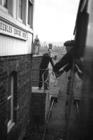 The driver of the 0744 Edinburgh-Peebles-Galashiels DMU exchanges single line tokens with the signalman at Peebles Engine Shed signal box on 3 February 1962, the last day of passenger services on the line.<br><br>[Frank Spaven Collection (Courtesy David Spaven)&nbsp;03/02/1962]