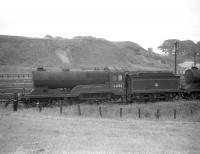 Robinson D11 4-4-0 no 62682 <I>Haystoun of Bucklaw</I> is one of a number of stored locomotives at Polmont in 1960. This one was not officially withdrawn from Eastfield shed by BR until July of the following year and was cut up at Inverurie works two months later.<br><br>[Robin Barbour Collection (Courtesy Bruce McCartney)&nbsp;//1960]
