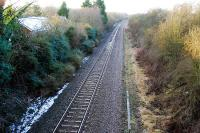 Looking west to Hereford at the closed Ashperton station. There is still a station building to the left and is that the edge of the platform amongst the undergrowth?<br><br>[Ewan Crawford&nbsp;31/01/2010]