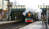For just a brief moment, surprised commuters at Leyland on 4 February think their service to Liverpool has been upgraded, when 60163 <I>Tornado</I> appears with the Royal Train on its way to Manchester.<br><br>[John McIntyre&nbsp;04/02/2010]