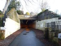 The refurbished Alloway Tunnel, recently cleaned up, re-lit, resurfaced and reopened as a cycle path [see image 25400]. View into the tunnel looking back from the Doon Viaduct on 6 February 2010.�The old telegraph wire insulator arms can still be seen on the wall to the left, together with a new plaque marking the site of the well (beyond the fence) <I>Whare Mungo's mither hang'd hersel'</I> in <I>Tam O'Shanter</I>.<br><br>[Colin Miller&nbsp;06/02/2010]