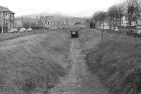 View west from King Street, Crieff, in late February 1970 towards the bridge carrying Burrell Street (A822) over the trackbed.   <br> <br><br>[Bill Jamieson&nbsp;/02/1970]