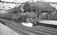 Thompson B1 4-6-0 no 61272 stands with a train at Sheffield Victoria in the 1960s. The station was closed to passengers in 1970 and has since been demolished [see image 7126].<br><br>[Robin Barbour Collection (Courtesy Bruce McCartney)&nbsp;//]