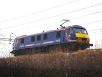 First ScotRail liveried EWS 90021 runs north light engine approaching Winsford Station on 13 January 2010.<br><br>[David Pesterfield&nbsp;13/01/2010]