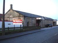The former railway goods shed at Ashbourne in December 2009. Now surrounded by major new developments all around but still in use with a new company sign at the south west corner of the building.<br><br>[David Pesterfield 10/12/2009]