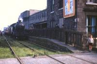 An SLS Railtour stands at the original Edinburgh & Dalkeith Railway terminus at South Leith on 25 August 1962 behind Gresley V2 2-6-2T no 67668. This was the first passenger station in Leith, opened in 1832 as plain 'Leith', with the prefix 'South' being added in 1859. Date of final closure to passengers varies between 1903 and 1905, dependent on source of information and definition of 'last passenger train'. [See image 11374]<br><br>[Frank Spaven Collection (Courtesy David Spaven)&nbsp;25/08/1962]