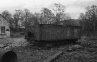 The body of a tender, which was donated to the Strathspey Railway when Lochgorm Works in Inverness was redeveloped, is seen at the Aviemore shed site in April 1979. It was evidently a 'lost cause' and was sent to landfil as it wasn't suitable for scrap.<br><br>[John McIntyre&nbsp;/04/1979]
