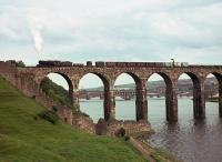 A northbound freight drifts off the Royal Border Bridge in the summer of 1964. The photographer's great-great-grandfather was a stonemason who helped to build the bridge between 1847 and 1850.<br><br>[Frank Spaven Collection (Courtesy David Spaven)&nbsp;//1964]