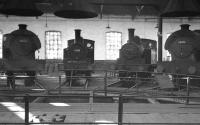 A real North Eastern scene inside one of the roundhouses at West Hartlepool. Lineup from left to right is J94 68056, J72 68715, J72 68711 and J94 68051. The photograph is thought to have been taken in March 1961. West Hartlepool shed was officially closed by BR in September 1967.  <br><br>[K A Gray&nbsp;26/03/1961]