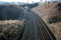 View south over Flex cutting in 1971, with track lifting in progress on the Waverley route approximately two miles south of Hawick station. [See image 22730]<br><br>[Bruce McCartney&nbsp;//1971]