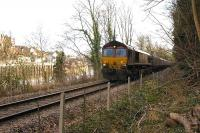 Coal empties heading back to Portbury coal import terminal run west alongside the Avon on 9 February, photographed passing Rownham.<br><br>[Andy Kirkham&nbsp;09/02/2010]