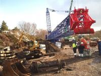 Scene alongside Carrbridge station on 12 February 2010, showing part of the 1000 tonne crane being assembled in readiness for 'the big lift'. <br><br>[Gus Carnegie 12/02/2010]