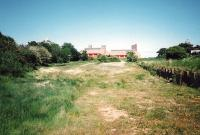 The station site at Gullane in June 1995, looking towards buffer stops. The branch had lost its passenger service as long ago as 1932, but remained open for freight until 1964. The site was redeveloped shortly after the photograph was taken and is now a housing estate.<br><br>[David Panton&nbsp;/06/1995]