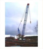 <I>See me!</I> The fully assembled 1000 tonne crane stands alongside Carrbridge station on 12 February 2010 ready for <I>the big lift</I> [see image 1503].<br><br>[Gus Carnegie 12/02/2010]